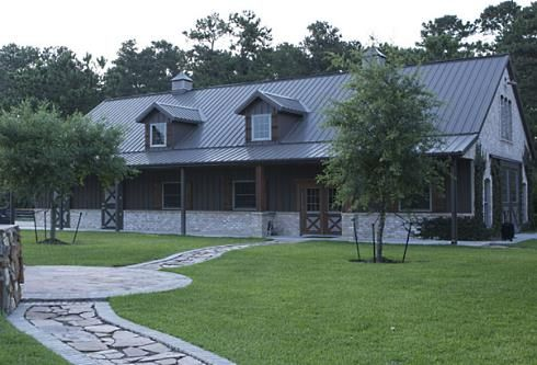 pole barn house plans | note the stone half wall along the front - it really warms up the metal barn look.