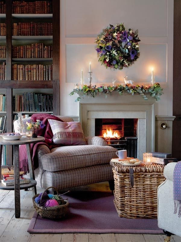 Lovely relaxed  cosy feel to this Simple country style living room. Good use of large basket as coffee table. Love the bookcase  old books.
