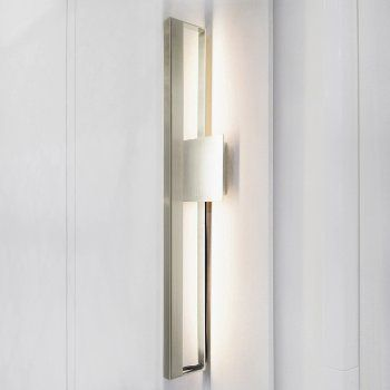 Bar LED Wall Sconce - like this one you can get it in copper which would work nicely with everything else.