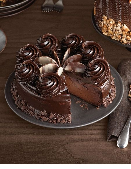 Luscious looking chocolate cheesecake with ganache swirls. Now I'm hungry.  Pinterest is bad for my waistline!  :-)