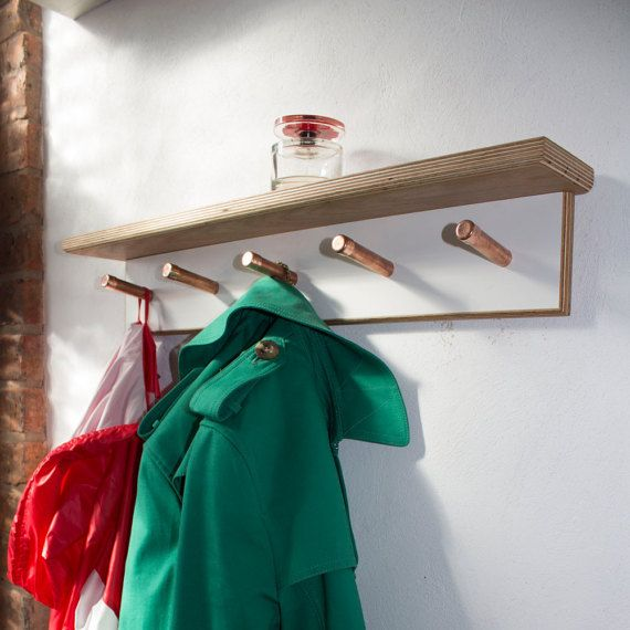 A handmade contemporary coat hook with five hooks, using oak veneered plywood,melamine and copper.