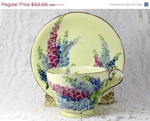 ON SALE 1930s Aynsley Wisteria Teacup Tea Cup and Saucer - Creamy Yellow J102 by TheVintageTeacup on Etsy https://www.etsy.com/listing/216299635/on-sale-1930s-aynsley-wisteria-teacup