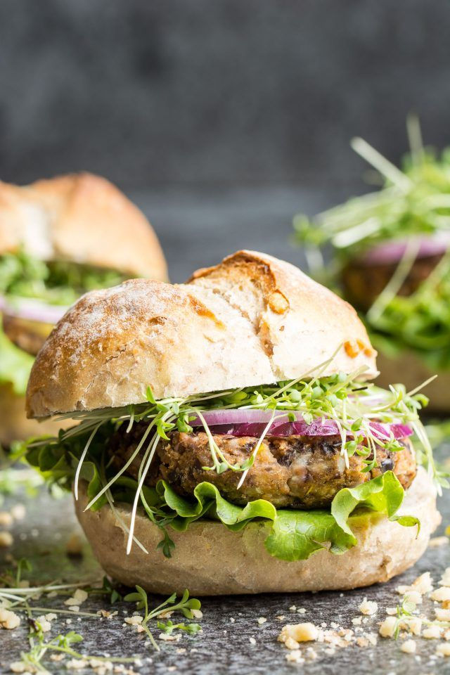 Super quick vegan black bean burgers. Ready in 15-20 minutes, these are packed with protein and fresh veggies, perfect for a late summer picnic!