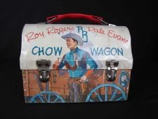 This lunch box, modeled after a Ponderosa wagon, features iconic Western television show characters Roy Rogers and Dale Evans. It was made in 1958 by Thermos. #westerns #television