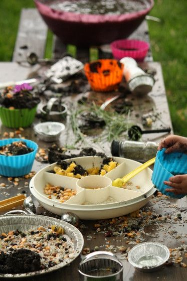 Can't wait to set this up for my kids. Mud kitchen: second hand coffee table set up with mud kitchen actvitiy
