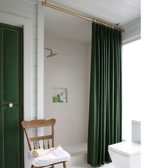 Suspend the shower curtain from the ceiling (extra-long rod) to give the illusion of a taller shower