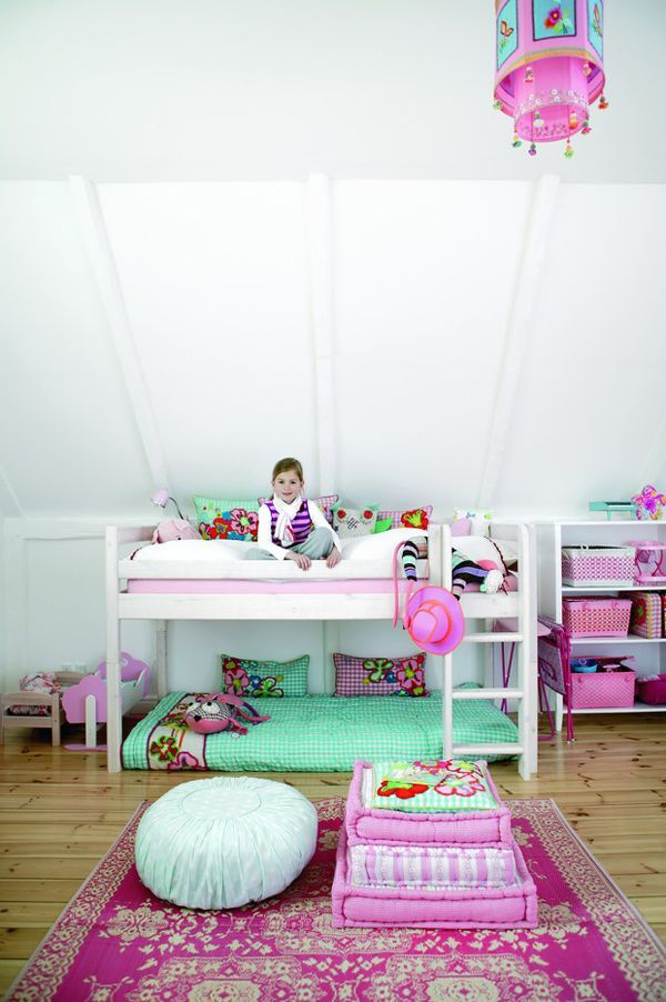Aqua and Pink. I like that the bottom of the bunk is set up on the floor. That leaves possibility of a bigger bottom bed.
