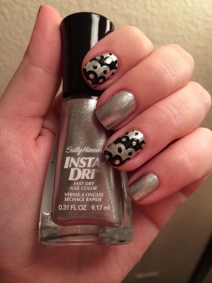Silver nails with black nail stamp design