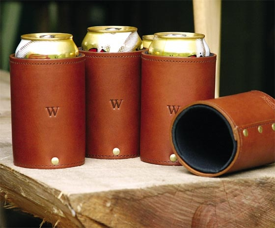 Hand crafted leather can caddy stitched and held together by brass rivets.