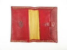 This is a deep red wallet with tan stitching and lining. Its all leather measuring 4 by 6. Its stitched all around the edges and has a embossed pattern in the center front of the red. It has four pockets inside plus the tabbed closure runs the full length (7¾) inside. Its in lovely vintage condition, soft and supple with the 1943 date stamped inside.  Im happy to ship outside the United States; please convo for a mailing cost.  Thanks for thinking Retro