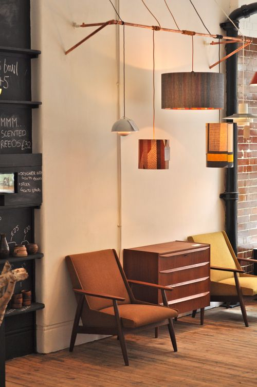 Row of pendant lamps offset from wall....