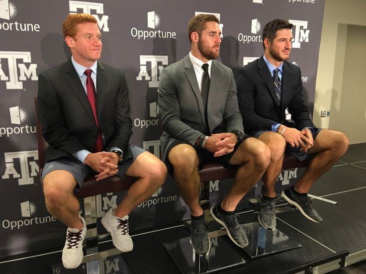 In one of the odder instances of the Texas A&M football season, the Aggies' quarterbacks showed up together at Tuesday's weekly press conference in coats and ties - and shorts.