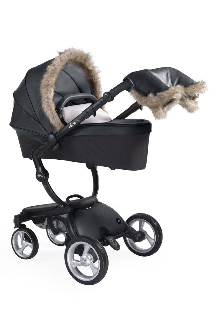 A three-part cover made to fit over your Mima Xari Stroller in Carrycot mode protects your little one from cold weather thanks to waterproofing and a felted interior that helps with insulation. The set comes with a transparent wind protector, removable faux fur trim for the canopy cover, a footmuff for baby and a cozy handmuff trimmed in faux fur to keep your hands warm as you push the stroller.