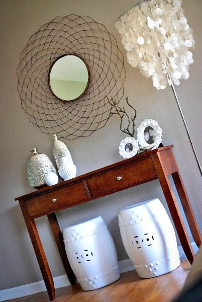 Nuestra Vida Dulce - entrances/foyers - Sherwin Williams - Perfect Greige - garden stools, round mirror, capiz, urban outfitters branch, per...