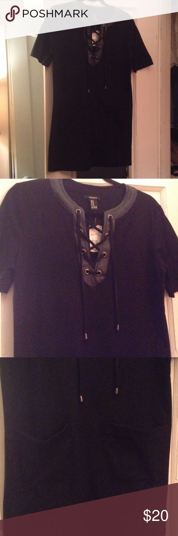 Forever 21 Faux Suede Dress Forever 21 Faux Suede Black Dress with Front Pockets & Faux Leather Trim Collar with Lace Tie.  Short Sleeves. Size Medium. Approx 32 inches length. 91% Polyester 9% Spandex. New with tags Forever 21 Dresses