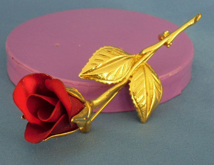 A personal favorite from my Etsy shop https://www.etsy.com/listing/84443963/vintage-red-rose-petal-brooch-bp34