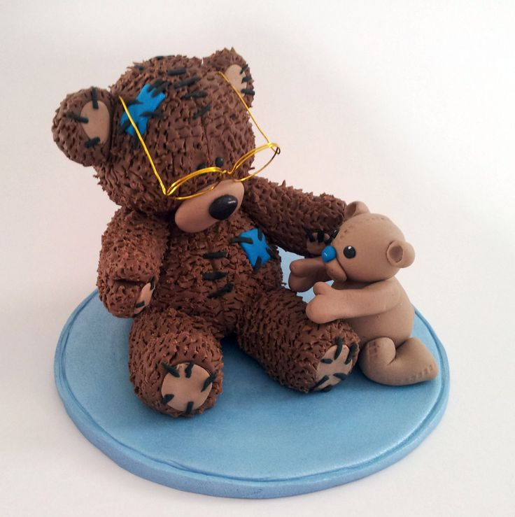 Inspired by Tatty teddy I've made a grandad teddy and a baby teddy in chocolate fondant, for a baptism cake.