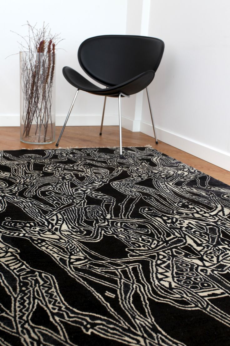 """Dance In The Bush Of Ghosts"" by Bruce Onobrakpeya reinforces the black and white contrast in this space. #interiordesign #rug #africanart http://africaonthefloor.com/"