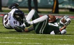 Jets quarterback Geno Smith gets sacked against Ravens