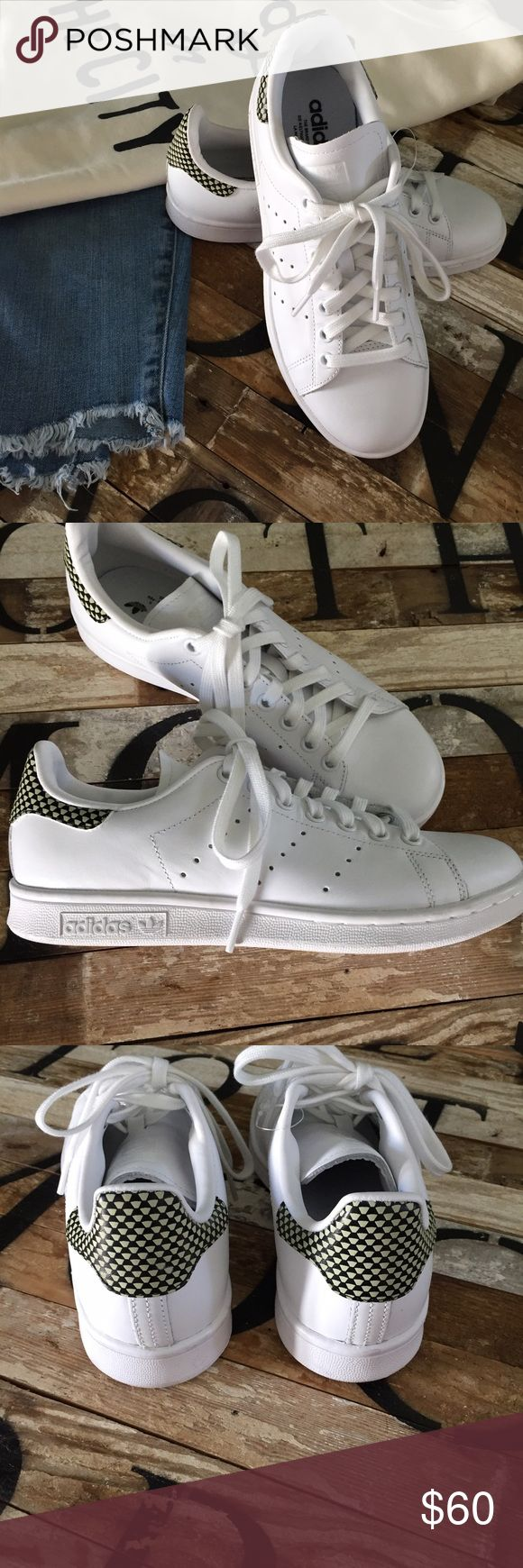 🆕 Adidas 👟👟Stan Smiths 👟👟 Brand-new, only tried on, never worn! All white leather with cool graphic back tab. These are marked a men's 6 1/2 which is equivalent to an 8 1/2 woman's. I'm a true nine and these are a little snug on me -only reason I'm letting these go!! If you are not sure of your size in these, please go to a store and try them on first. Smoke free home and fast shipper:) Adidas Stan Smith Shoes Sneakers