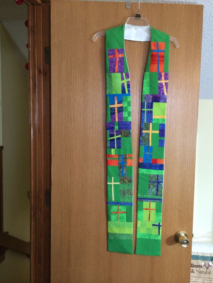Stole made for our pastor. Each member of our Prayer Shawl/quiltMinistry made a cross from the fabric from paraments we made for church.
