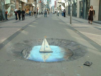 Julian Beever is an English artist who's famous for his art on the pavement of England, France, Germany, usa, Australia and Belgium. It's particularity ? Beever gives to his drawing an anamorphose, his images are drawn completly diforms which give a 3D image when viewed from the right angle … see for yourself it's amazing !!!
