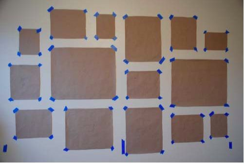 Hanging a gallery wall can be a challenge. A great tip to avoid putting so many unnecessary holes in your wall is to cut out the frame sizes using butcher paper. Attach with painters tape and move them around