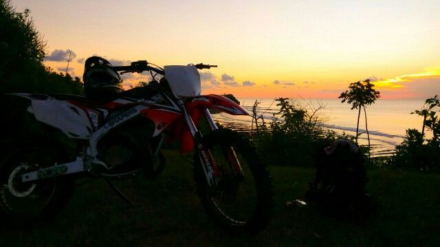 · Day burns down to night. Burns the edge of my soul. In the night I break into sparks of suns and become fires in a dust of bones. Night knifes my breaths, swallow whole my tounge. Turn back. Reverse. Return. Mashaa #Allah, what a #beautiful #sunset after #MX practice today.