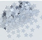 Srebrne gwiazdki świetnie wyglądają na ciemnym obrusie.