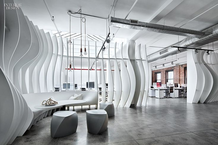 Fins of laser cut painted birch plywood wrap the lounge for Interior design directory nyc