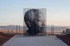 50 steel column constructions up to 9.5 metres tall come into alignment to form a portrait of Nelson Mandela against a backdrop of rolling hills and valleys at the Nelson Mandela Capture Site outside the town of Howick in KwaZulu-Natal