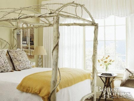 Canopy bed made of saplings and branches. Could easily be bolted to a steel  bed