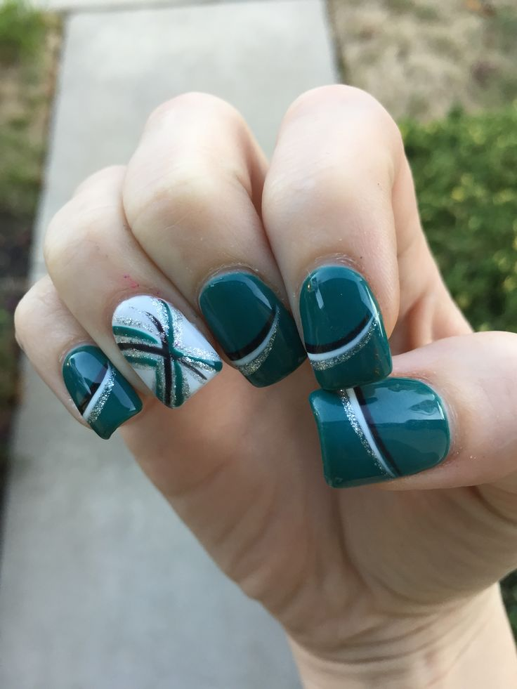EAGLES NAILS!!!! These are actually my nails, I took a design I saw and tweaked it. The accent nail was completely designed by my manicurist (she's awesome). Green is OPI gel-nail polish called AmazON AmazOFF.