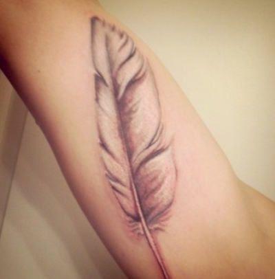 A Paisley Feather Tattoo Design That Symbolizes Spirituality ...