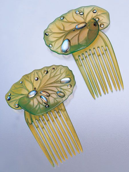 Ella Naper. 1886-1972. Lily-pad hair combs. Green-tinted horn, with moonstone dewdrops. Length: 9 cm  Width: 6.8 cm. English, c. 1906. Sold by Tadema Gallery. View 2.