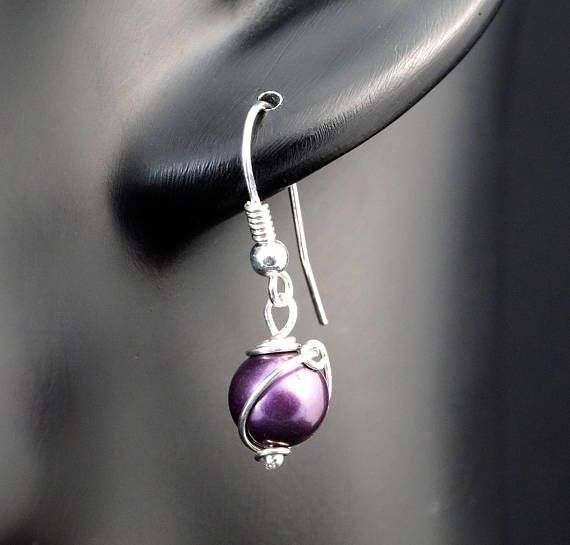A delicate, unique, handmade, wire wrapped earrings with cultured natural pearl. Earrings were designed and made by Me, using an extremely labor-intensive and precise wire-wrapping technique, with silver 925, 930 and 999.  Dimensions of earrings: length: 2.9 cm 1.14 inch width: 0.8 cm 0.31 inch  You receive these unique earrings in jewelry box, so theyre ready to be a gift.   Refunds and Exchanges:  If you are not satisfied with your purchase for any reason, please contact me before leaving…