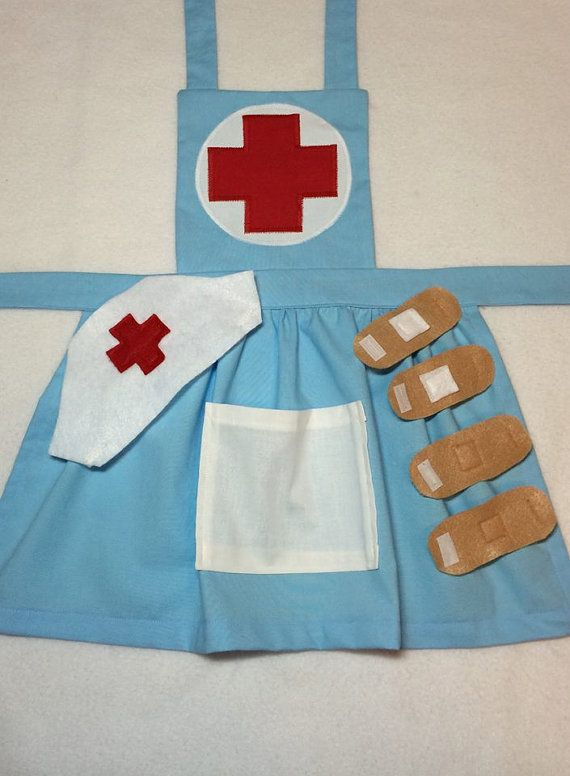 Let your child step back in time with this vintage looking nurse apron! From a birthday party, to Halloween to everyday creative play, this nurse apron will fit your needs. Your child will love dressing up and playing nurse and you will love how adorable they look! The apron has straps that tie in the back while the neck straps connect with velcro. The white pocket in the front is the perfect size for play accessories. The nurse apron comes with a white felt hat with an elastic band. There…