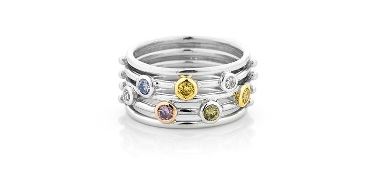 Wide open wire ring with rare multi coloured natural diamonds in bezel settings. 18ct white gold