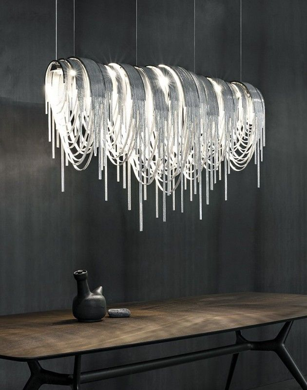 The volver led suspension light has been designed by studio 14 for manufacturer terzani this luxurious led suspension light is terzanis first combining