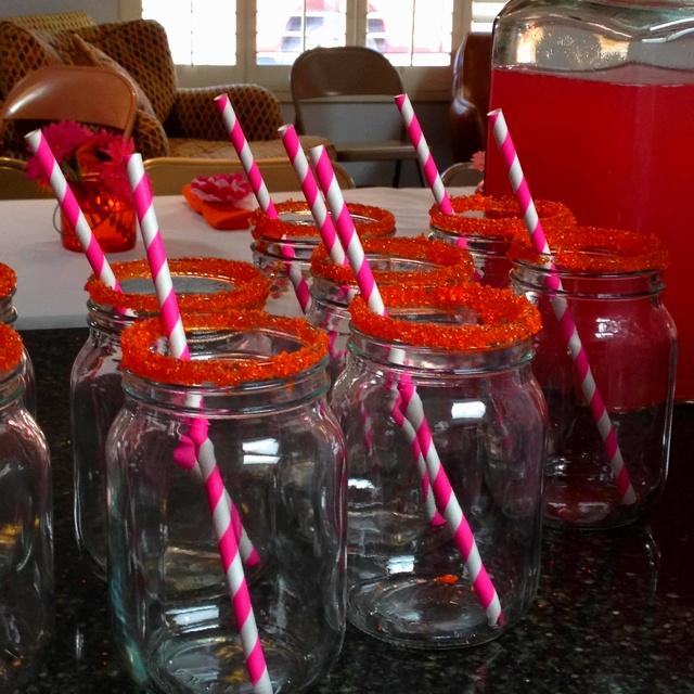 My friend's pink and orange bridal shower. Mason jars with orange sugar rims and pink and white straws.