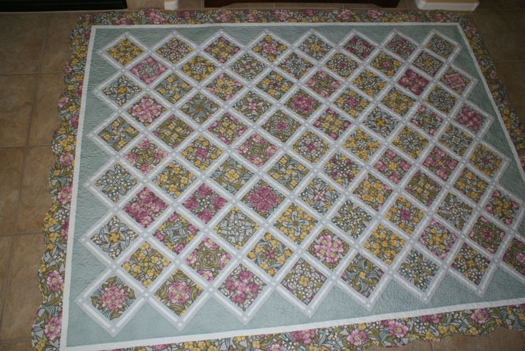 The pattern is called 4 patch posie and changes a floral for Garden trellis designs quilt patterns