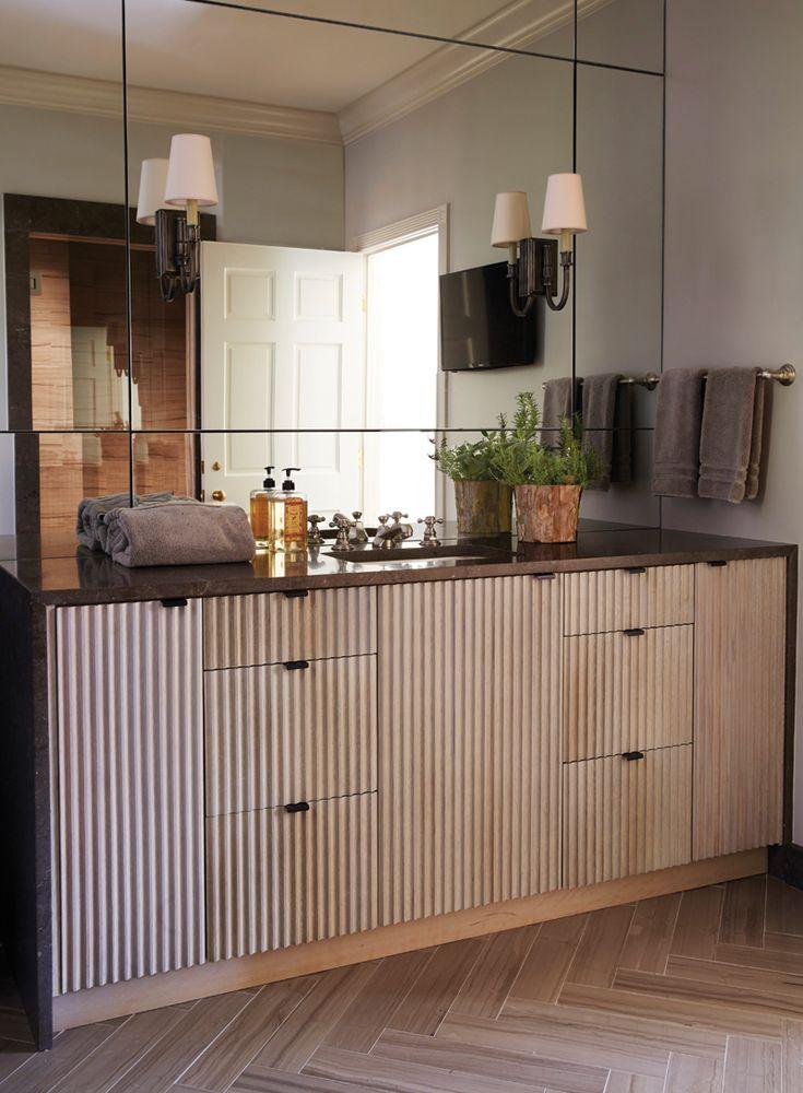 Modern Bath With Fluted Cabinets And Herringbone Floors Bathroom Design