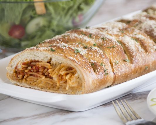 Braided Spaghetti Bread Scott, who works in the Rhodes Bake-N-Serv computer department, came up with this delicious recipe for his family.  He loves spaghetti and bread, and it just seemed right that they should go together!  It has become his wife's favorite Sunday meal. #rhodesbread