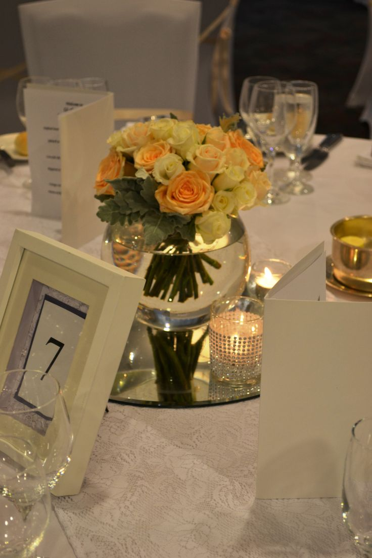 Peach and cream wedding reception guest table centrepieces. Styled by Greenstone Events.