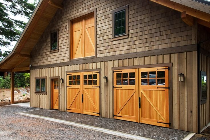 This beautiful building features Classic Z Brace doors, an entry door and loft doors all designed by Real Carriage Door Company.