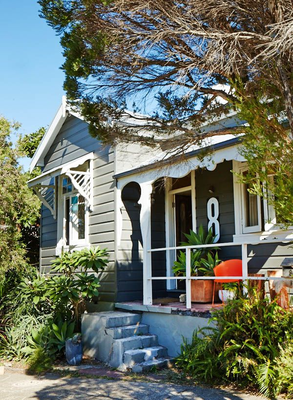 Cute exterior, love the large address number. I would have painted the steps and added a handrail perhaps.
