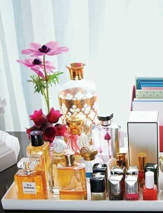 Stick It On A Tray:  There are some perfume bottle and skin care jars that are just too pretty to hide away in a drawer. Instead, use a tray (or repurpose a picture frame), and display all of your best items for everyone to see.