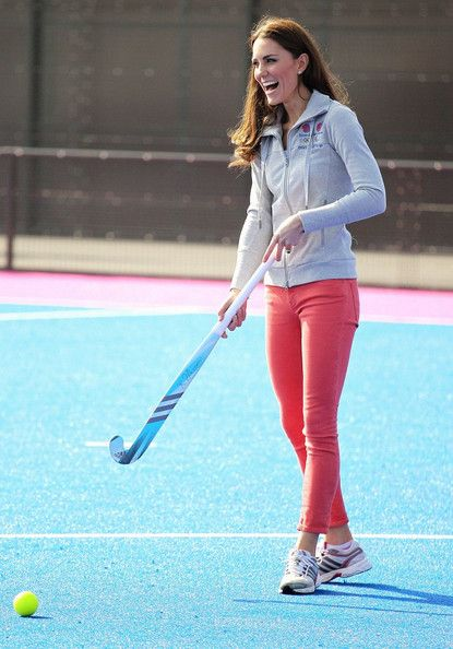 Catherine, Duchess of Cambridge tries her hand at field hockey as she meets the men's and women's GB Hockey Team at the Riverside Arena in the Olympic Park.