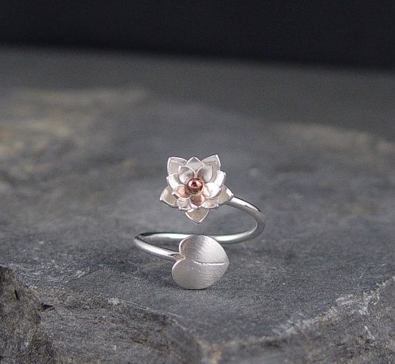 This silver Lotus Blossom and lily pad ring is completely handmade! The Lotus is made of 3 layers of silver with a bronze bead center. Size : Fits a US 6 - 8. My finger in the photo is a size 7.5. Finish: The blossom and band both have a shiny finish. The lily pad has a satin finish.   *****THIS ITEM IS MADE TO ORDER******   Please note all of my items are handmade and may have slight variations from the photo listing.