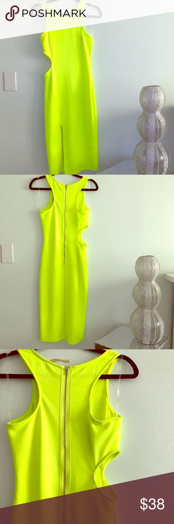 Neon yellow dress Neon yellow midi dress with small split in the from and cut out on one side. Beautiful bodycon dress. Worn once Dresses Midi